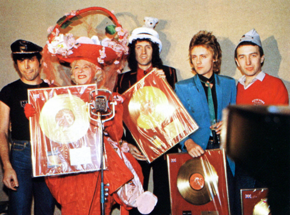 the-band-were-presented-with-gold-disc-awards-by-gertrude-shilling-at-the-crazy-hat-party-in-london-in-december-1979.jpg