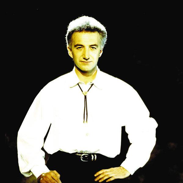 John-Deacon-queen-1991-promo.jpg